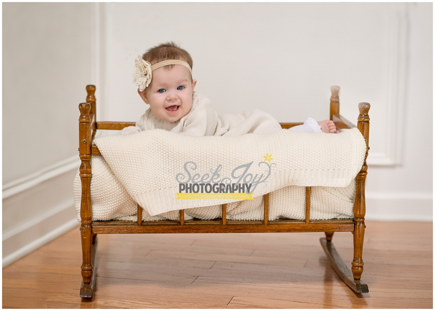 baby girl in vintage cradle