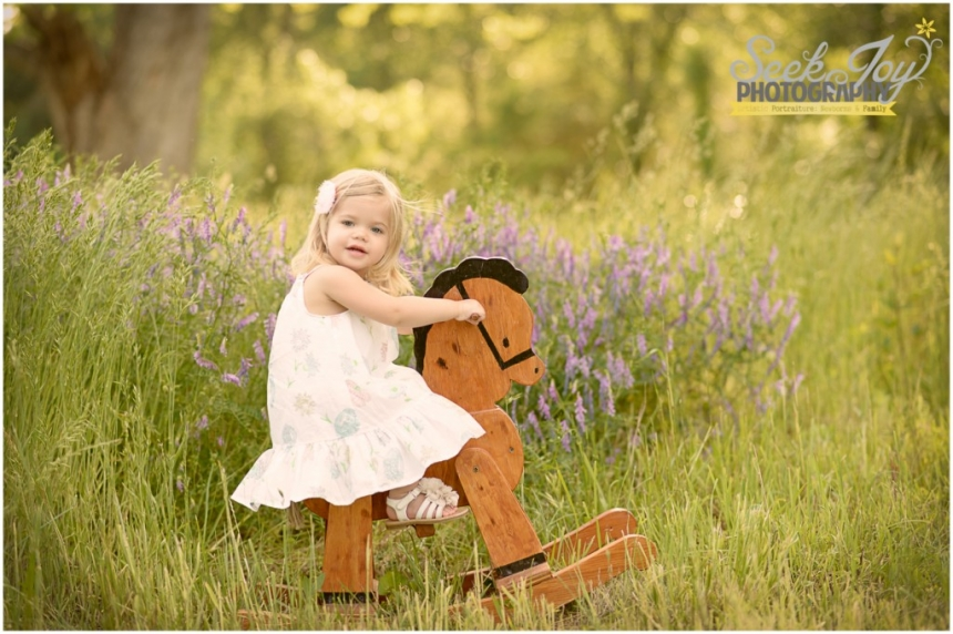 toddler girl rocking on rocking horse