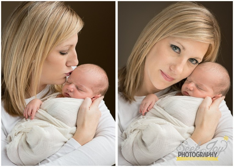 mother holding newborn son