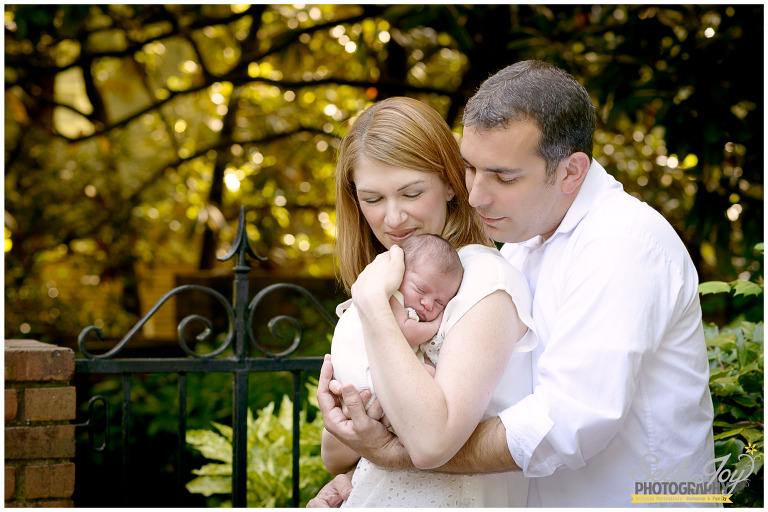 newborn girl with parents